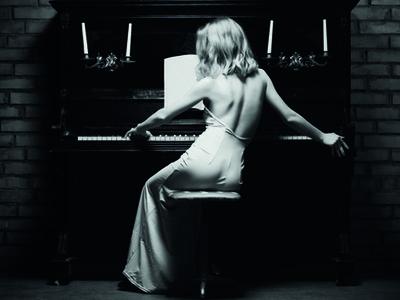 Woman using piano