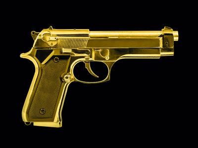 Isolated golden pistol