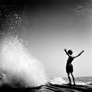 Boy in front of wave