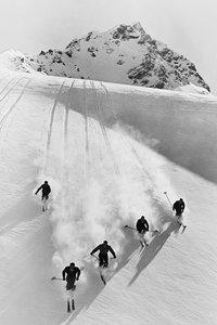 Five anonymous men skiing